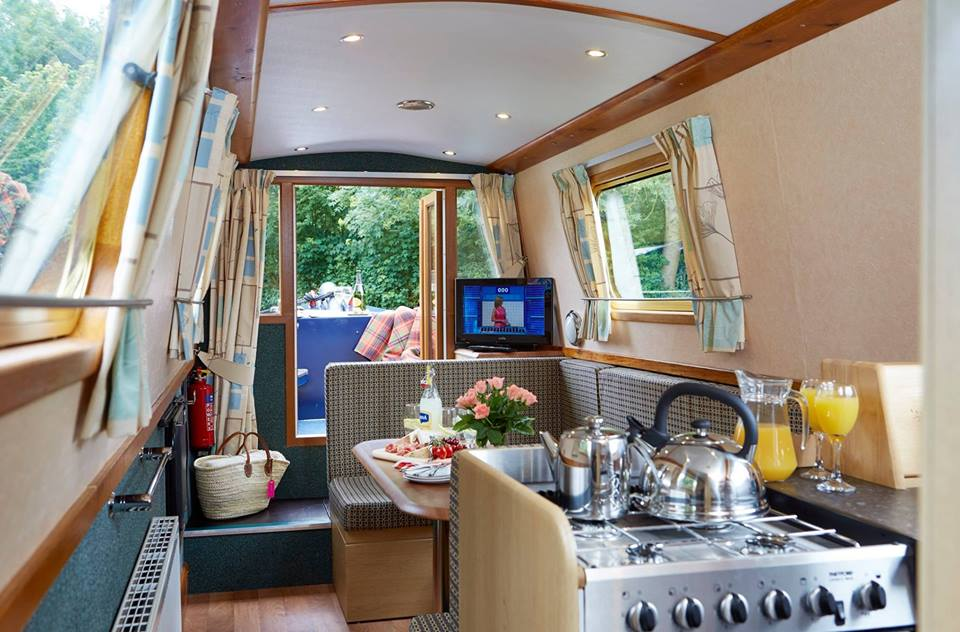 Inside one of our boats- the galley and saloon