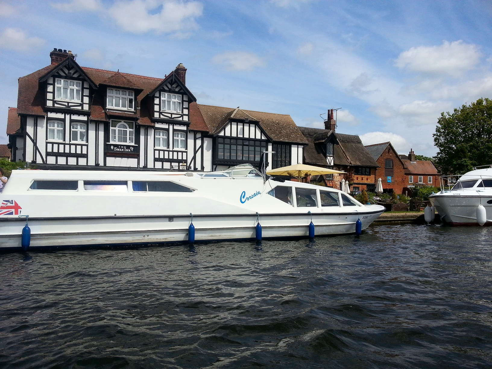 Hire boat from Brundall moored at 'The Swan Inn'