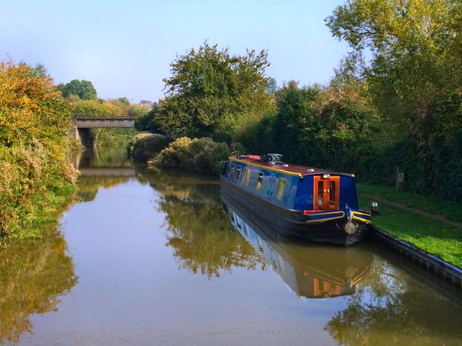 Narrowboat moored along the towpath